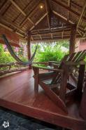 spacious balcony with 2 chairs and 1 hammock